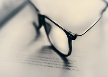 Photo of glasses on book