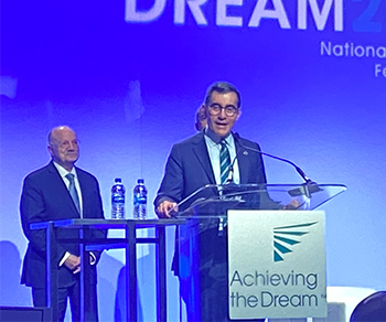 Chancellor Dr. Mike Flores accepting the 2020 Leah Meyer Award from Achieving the Dream in National Harbor, Maryland